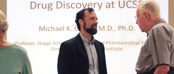 Dr. Michael Gilson presenting UCSD's drug discovery initiative at Vi at La Jolla Village.